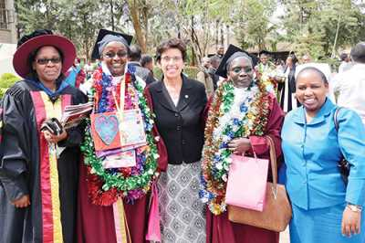 Sr. Rosemarie Nassif, SSND, Ph.D., Director of the Conrad N. Hilton Foundation's Catholic Sisters Initiative (center), was the keynote speaker for the graduation ceremony at CUEA (October, 2016). Here she poses with HESA graduates, ASEC directors, and Dr. Ann Rita Njageh, Deputy Director of  Academic Linkages of CUEA, after the ceremony.