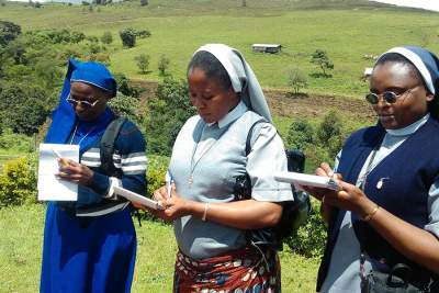 Sisters Theresia, Felicia and Evelyn busy taking notes during a site visit to the SHUMAS Biofarm