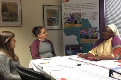 Program Evaluators Ms. Jennifer Mudge (left) and Ms. Tara Gregory (center), interview Sr. Bibiana (right), during her visit to Scranton in March.