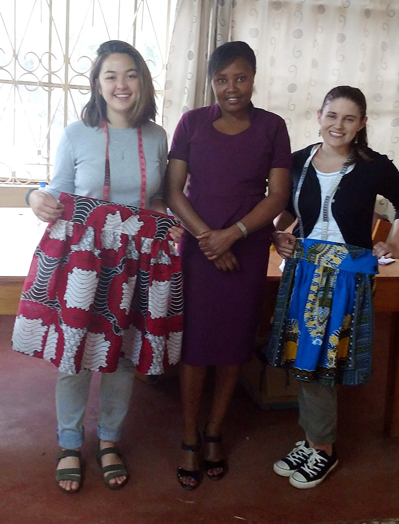 Making skirts with refugee women swing class with instructor Regina